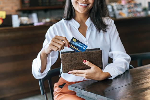 accepting-credit-cards-from-brown-purse-pay-goods_1150-18766