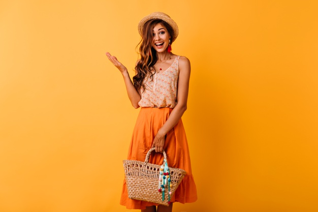 excited-ginger-lady-hat-holding-straw-bag-ecstatic-long-haired-girl-summer-outfit-enjoying-good-day_197531-11080